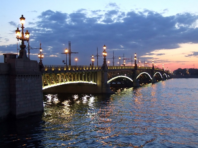 Illuminated bridge on white night in St Petersburg